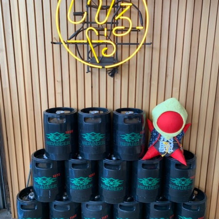 Beer kegs and Hida's Sarubobo doll