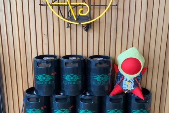 Beer kegs and Hida's Sarubobo doll